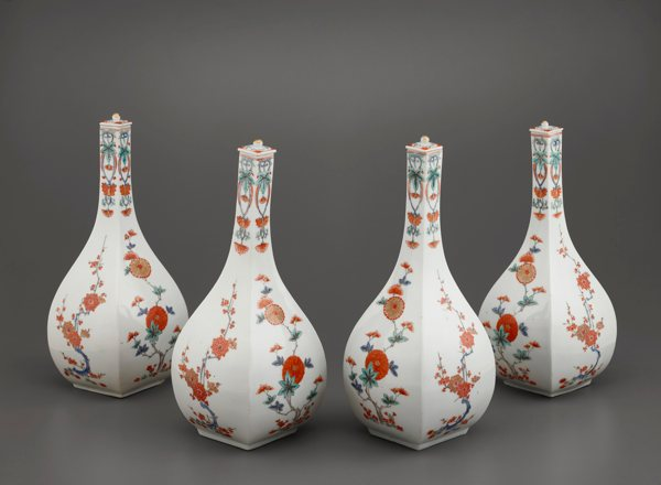 Image of Four wine bottles with covers