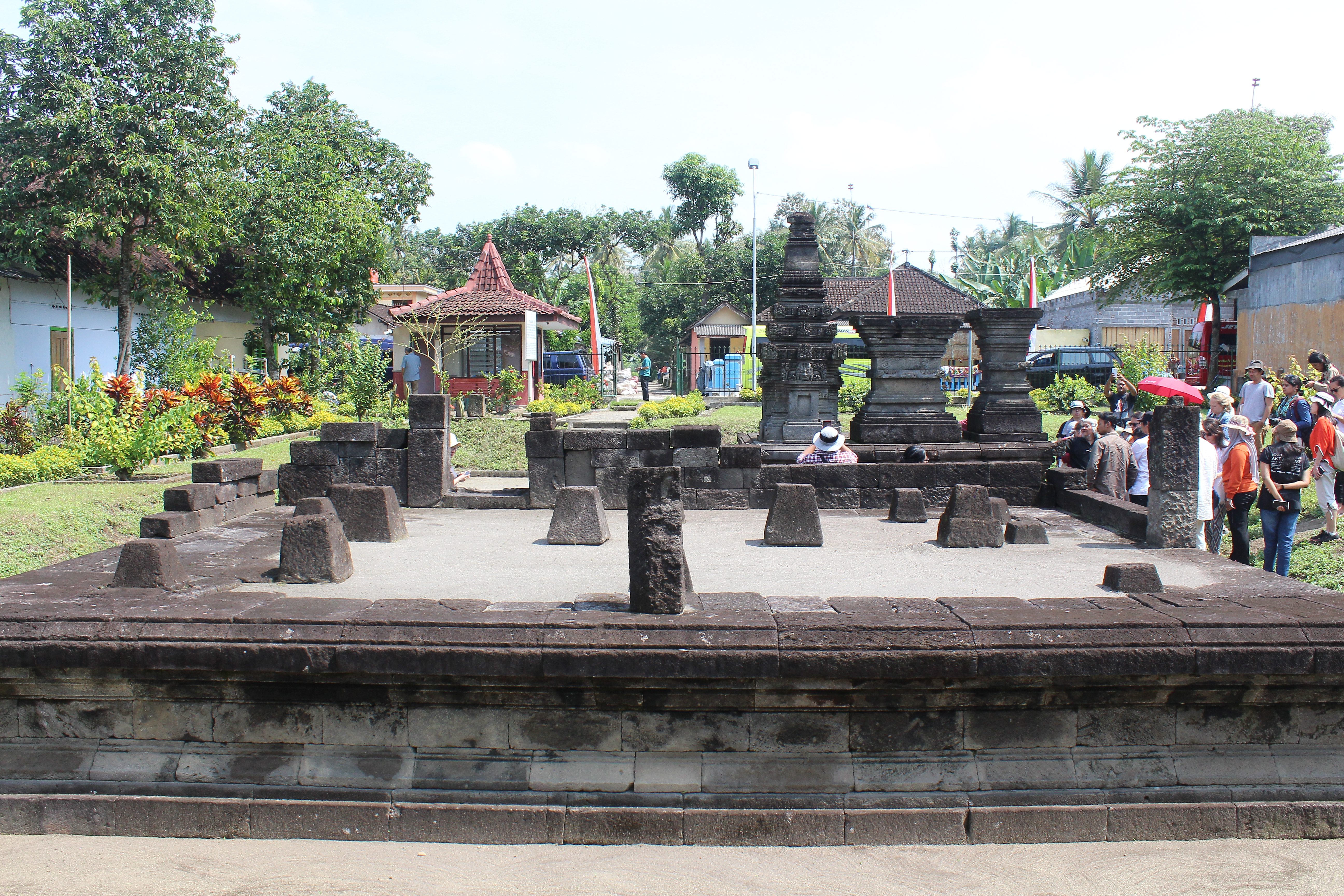 Sparsely remaining temple with cluster of people to the right