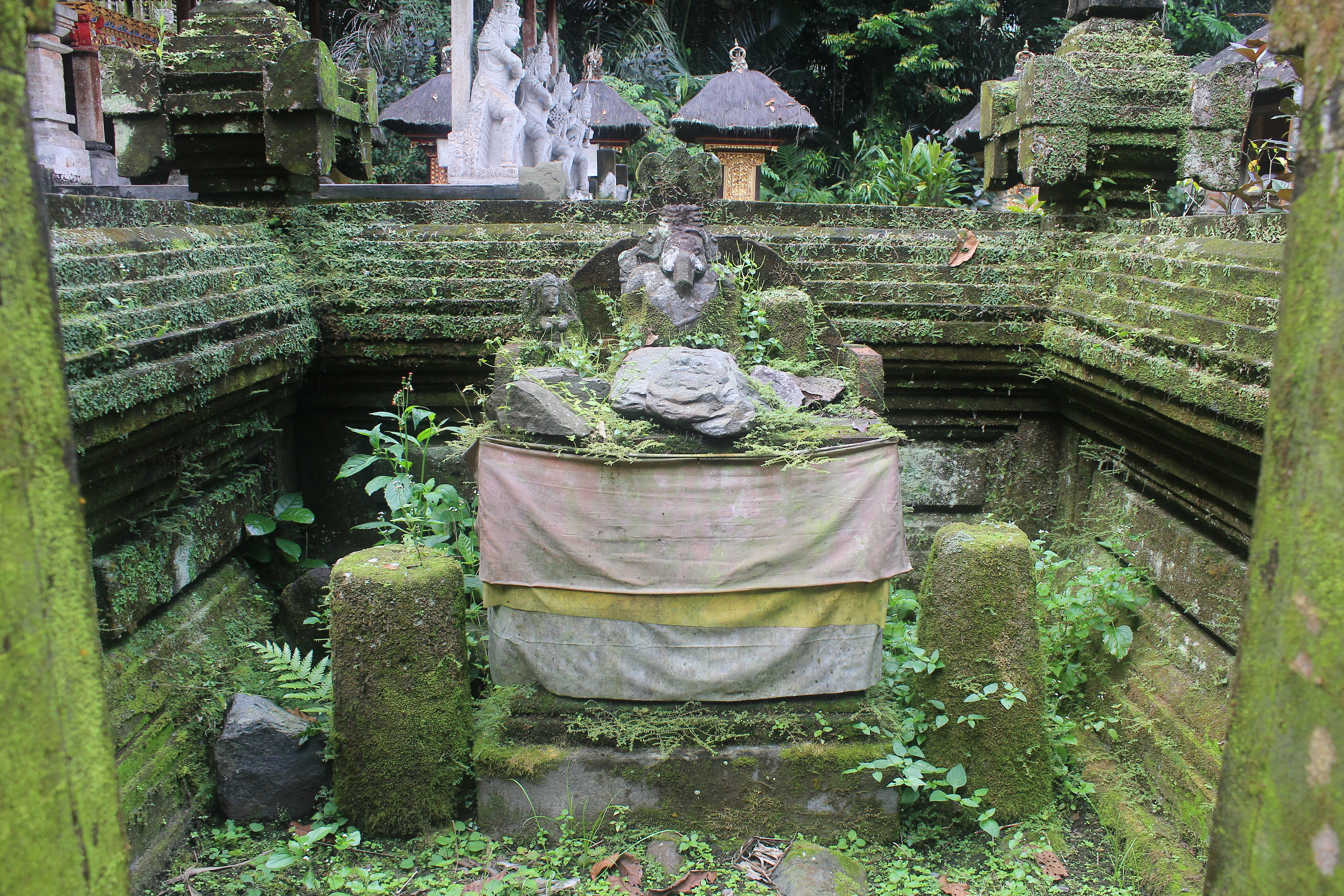 Overgrown low shrine with Ganesha