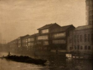 sepia toned view of buildings along a canal