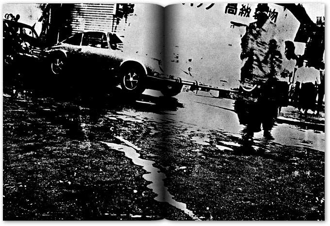 spread from provoke, a black and white image of a person on a street