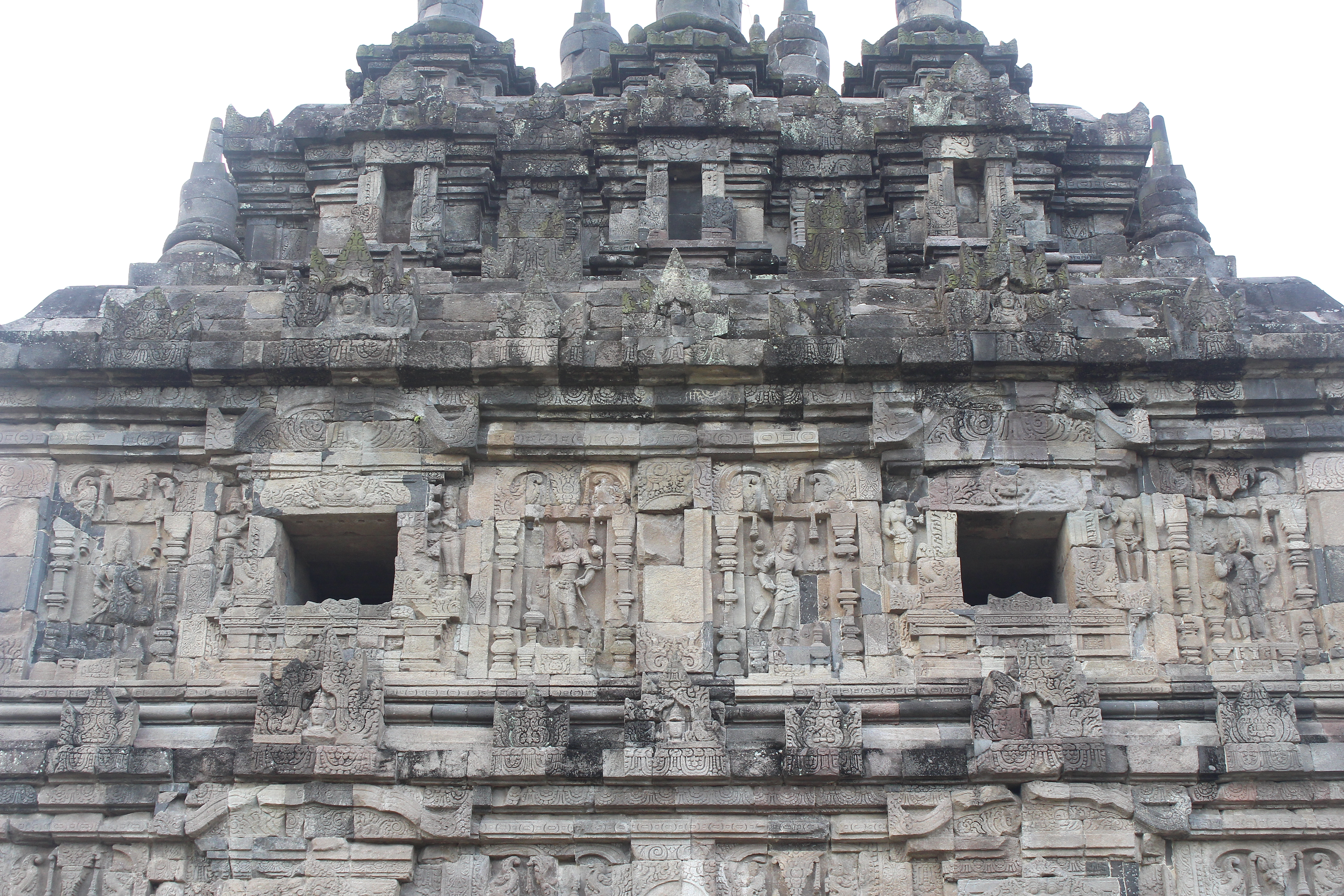 Large stone temple with relief carvings between two apertures