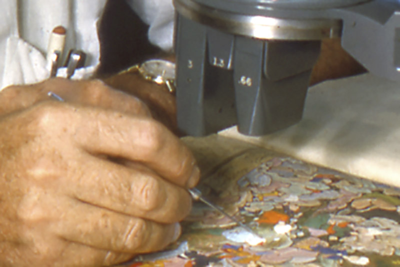 a conservator works on a mughal painting
