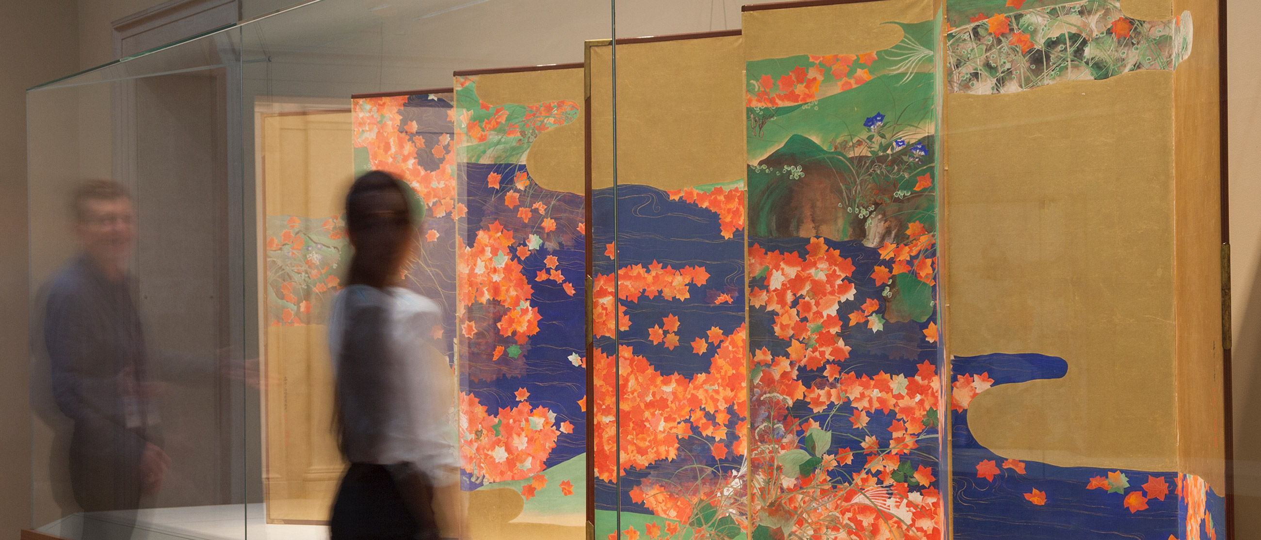 a visitor looks at a japanese screen